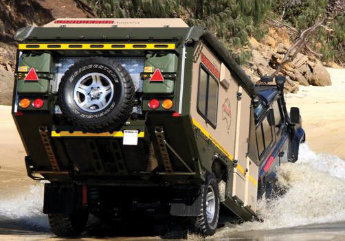 Conqueror Off-Road Campers going through a river
